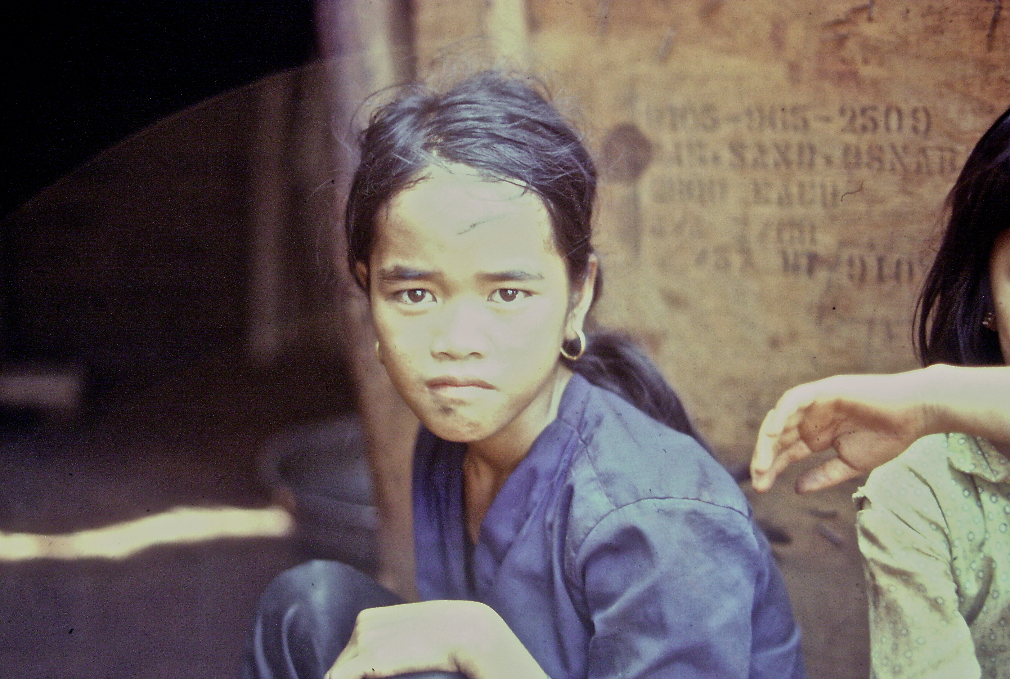 A young Asian woman looking sternly into the camera.