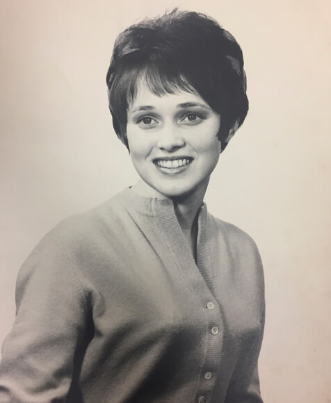 Black and white yearbook photo of a young woman.