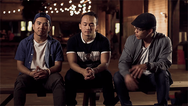 Contemporary photo of 3 young Hmong men sitting for an interview.