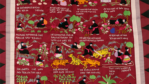 A red Hmong story cloth.