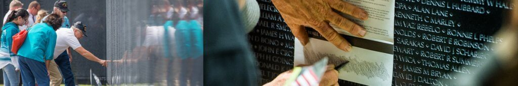 People touching the Wall That Heals and creating a rubbing of a name.