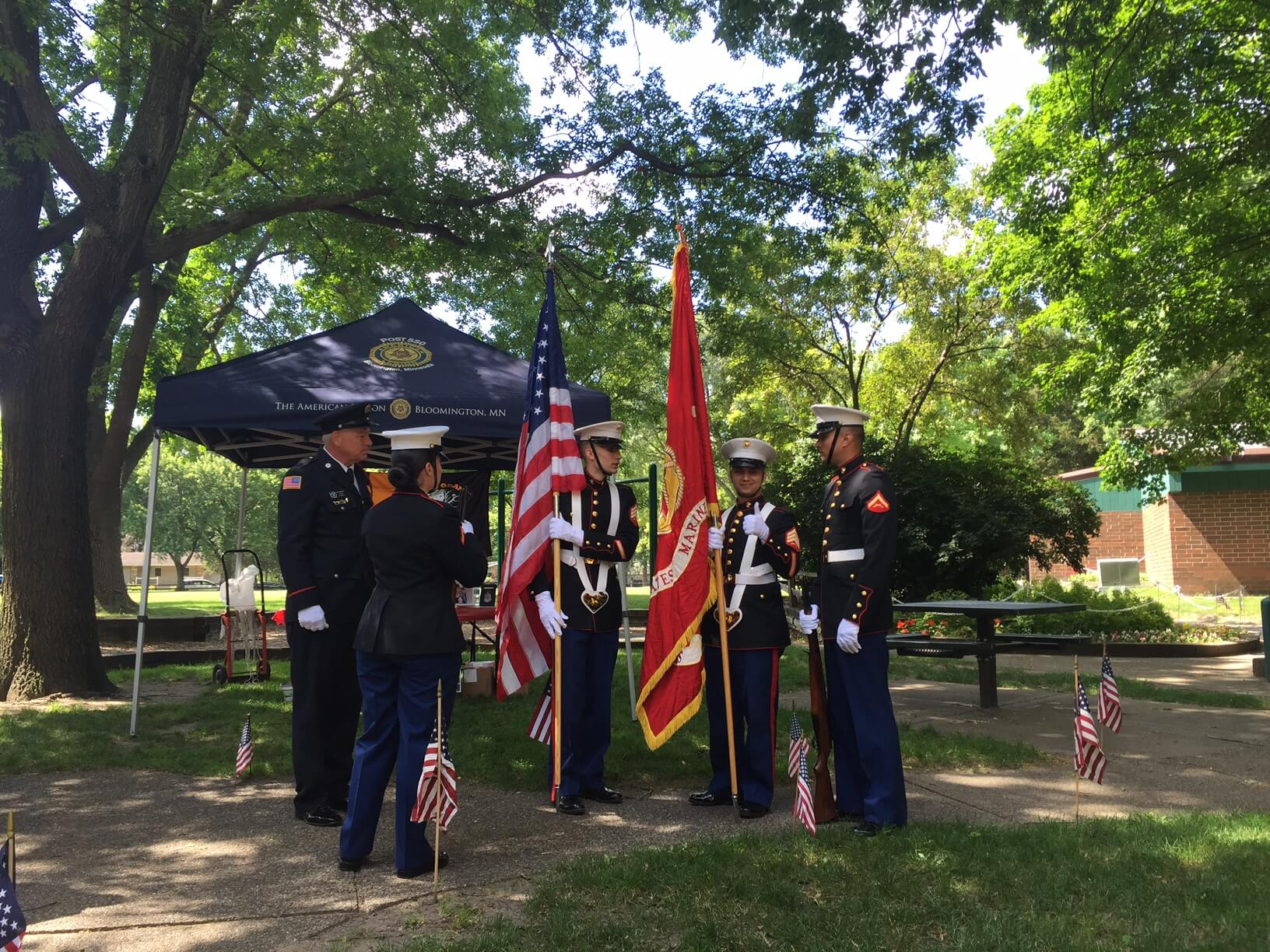 Military color guard with flags.