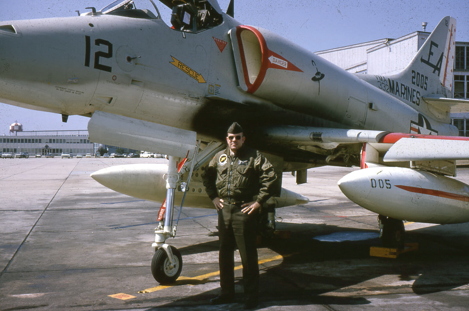 Pilot standing in front of a Marines airplane