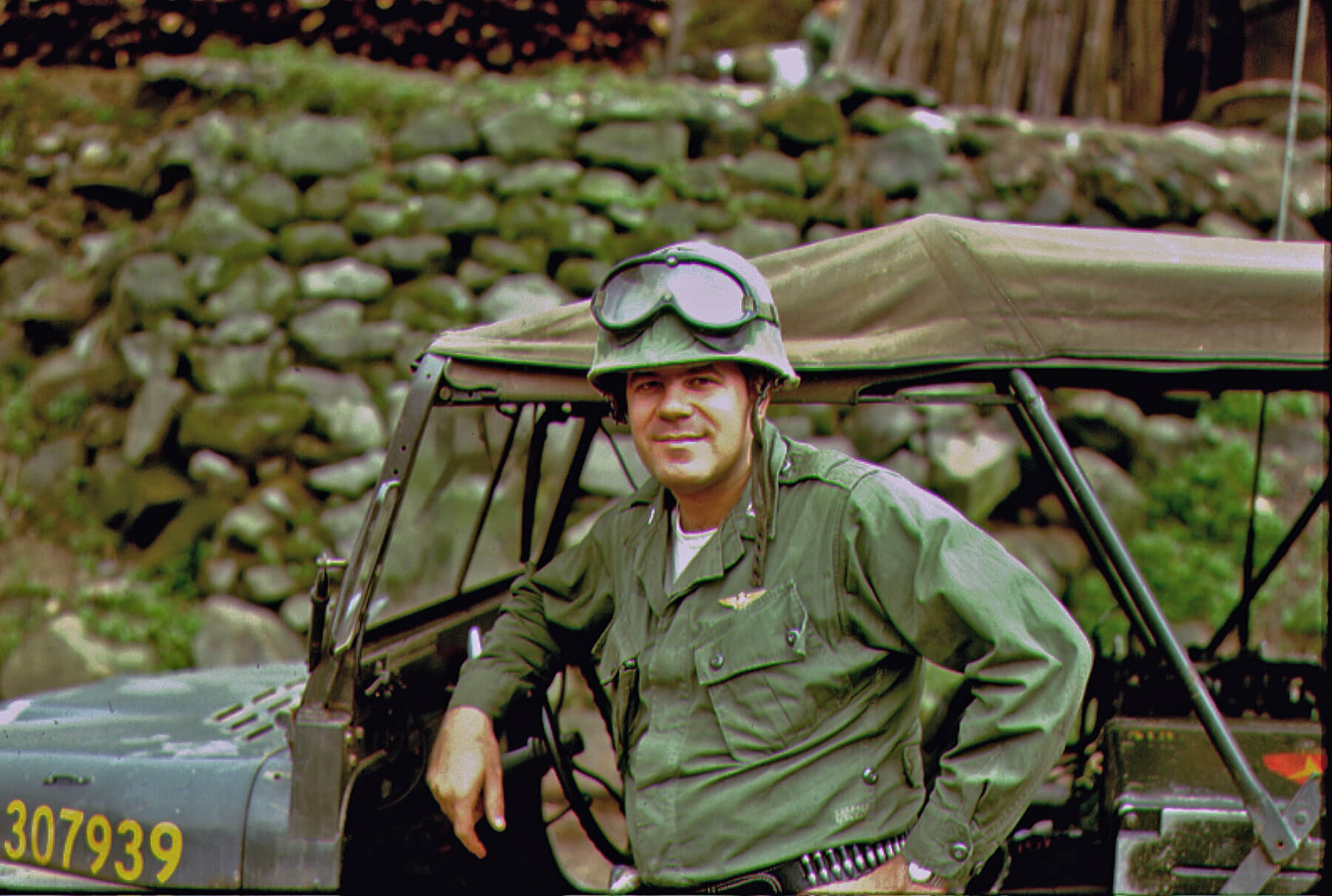 Pilot standing in front of a Jeep