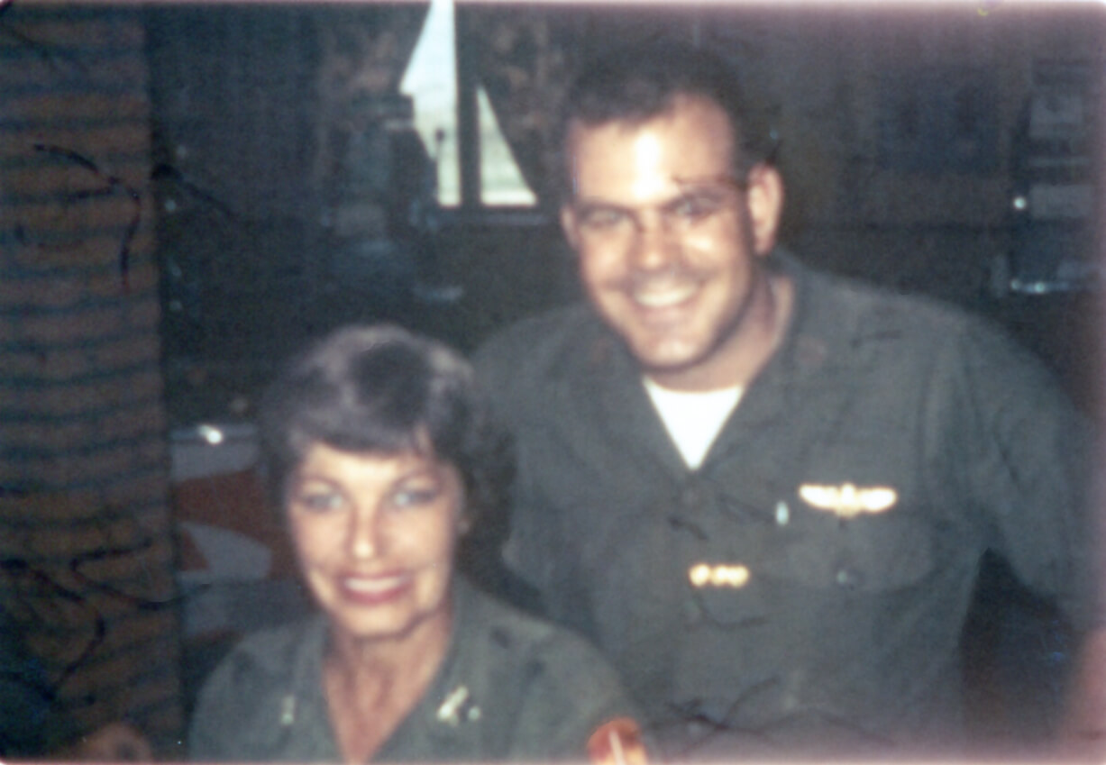 Man and woman in Vietnam War camp