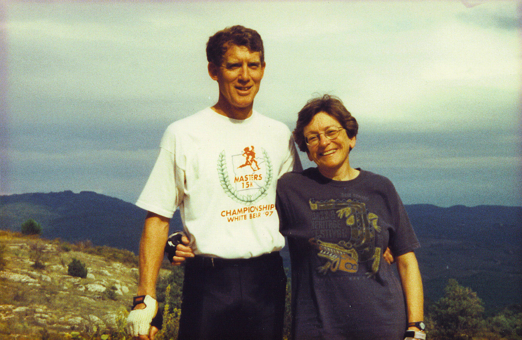 Couple on top of a mountain smiling