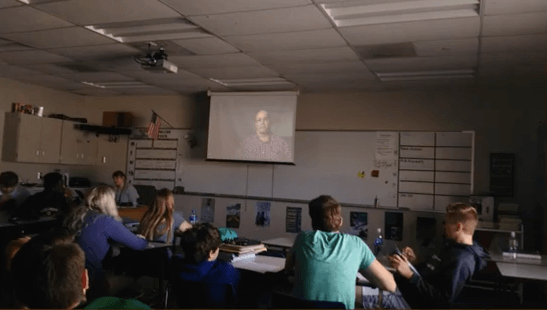 Classroom watching a video clip on a screen